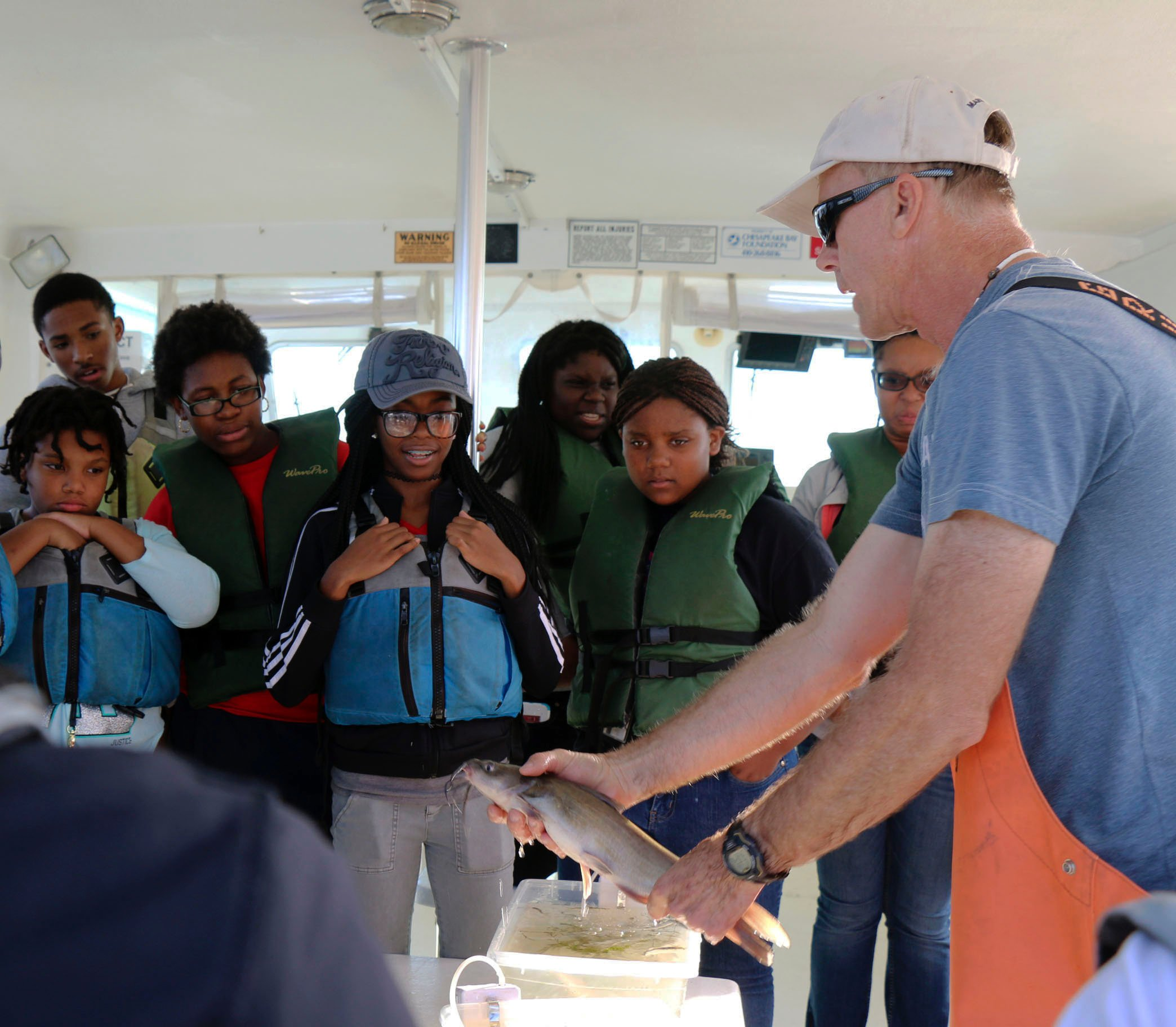 Students examine fish of the Potomac River